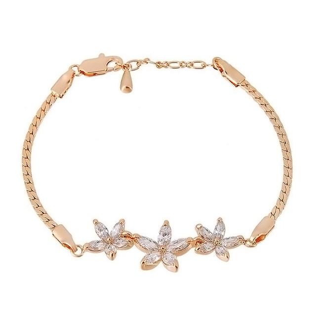 Браслет с кристаллами «Три цветка»Браслеты и чокеры<br>Изящный браслет с кристалликами в виде лепестков цветочков подчеркнет утонченность и добавит женственности своей обладательнице.<br>