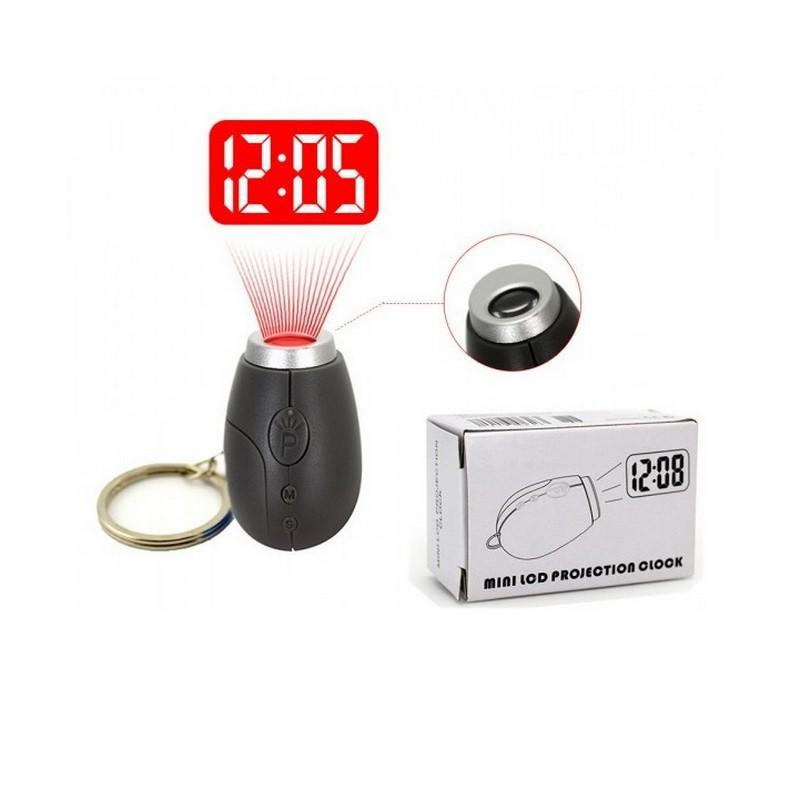 Мини часы-проекторОстальные брелоки<br>Хотите порадовать себя чем-то эксклюзивным или ищете маленький презент для любителя инновационных технологий? Мини часы-проектор станет настоящей находкой, поскольку покажет хозяину время на стене или потолке в темноте!<br>