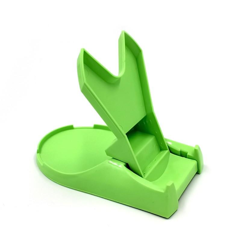 Подставка для крышки и ложки зеленая - Помогайка, Spoon and cover standОстальные гаджеты<br>Надоело убирать жир и грязь во время приготовления блюд? Инновационная подставка для крышки и ложки зеленого цвета «Помогайка» обеспечит чистоту на кухне! Поверхность стола не запачкаются! А вам не придется постоянно выдумывать, куда бы деть использованную ложку.<br>