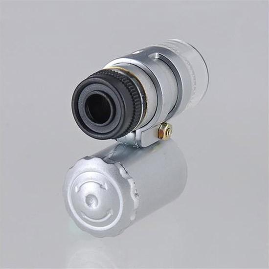 Мини-микроскоп с LED подсветкойОстальные игрушки<br>Микроскоп с тремя светодиодами белого и ультрафиолетового цвета для проверки старинных драгоценностей, благородного металла, купюр на подлинность. Полезен для юных исследователей как замена стационарному микроскопу.<br>