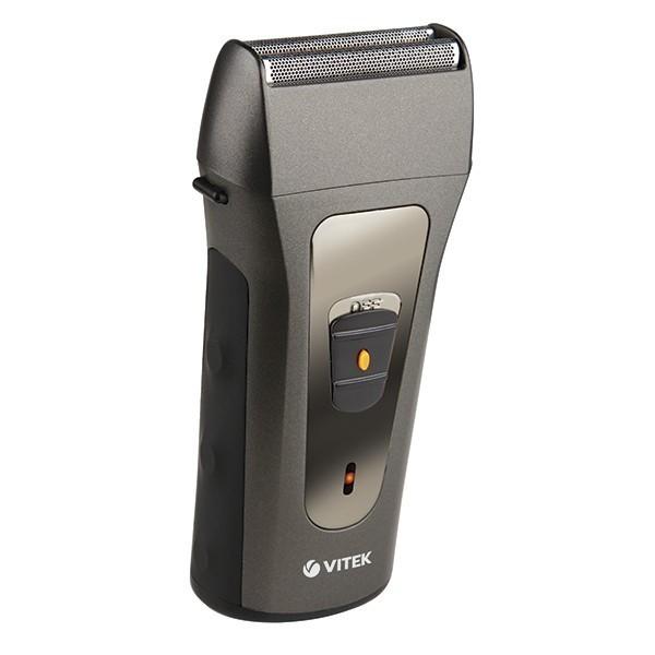 Бритва электрическая Vitek (две бреющие головки с двойными лезвиями) VT-8264(GY)Бритвы<br>Электробритва Vitek VT-8264 GY для сухого бритья имеет встроенный триммер для подравнивания висков, бороды и усов. На корпусе бритвы есть переключатель для перехода в режим работы триммера. Время работы Vitek VT-8264 GY от аккумулятора составляет 40 минут, а сам аккумулятор полностью заряжается за 5 ч. Индикатор зарядки подскажет, когда нужно подзарядить устройство.<br>