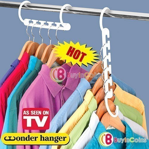 Вешалка для одежды Wonder Hanger (Уандер Хэнжер)Вешалки и органайзеры<br>Большинство женщин просто обожает шоппинг. А куда девать вещи, которые с годами только накапливаются в шкафу? Если ревизия и избавление от старых вещей вас не спасает, в шкафу царит бардак, а вы каждое утро вынуждены судорожно искать подходящие вещи для работы, то самое время купить универсальную вешалку для одежды Wonder Hanger (Уандер Хэнжер)!<br>