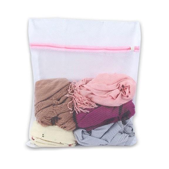 Мешок для стирки 40x50 смМешки и шарики для стирки<br>В век современных технологий женщины избавлены от тяжести каждодневной стирки, на помощь им пришли стиральные машинки. Но не редкость когда наши любимые вещи после стирки в стиральной машине выглядят намного хуже, чем до нее. Этого можно избежать, всего лишь используя мешок для стирки одежды.<br>