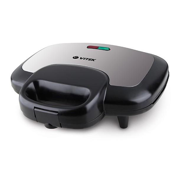 Сэндвичница Vitek из термостойкого пластика VT-7146(BK)Тостеры и сэндвичницы<br>Приготовить завтрак легко и быстро сможет любая хозяйка с сэндвичницей Vitek VT-7146 BK. Вкусный завтрак будет готов максимально быстро, о чем подскажет индикатор готовности.<br>
