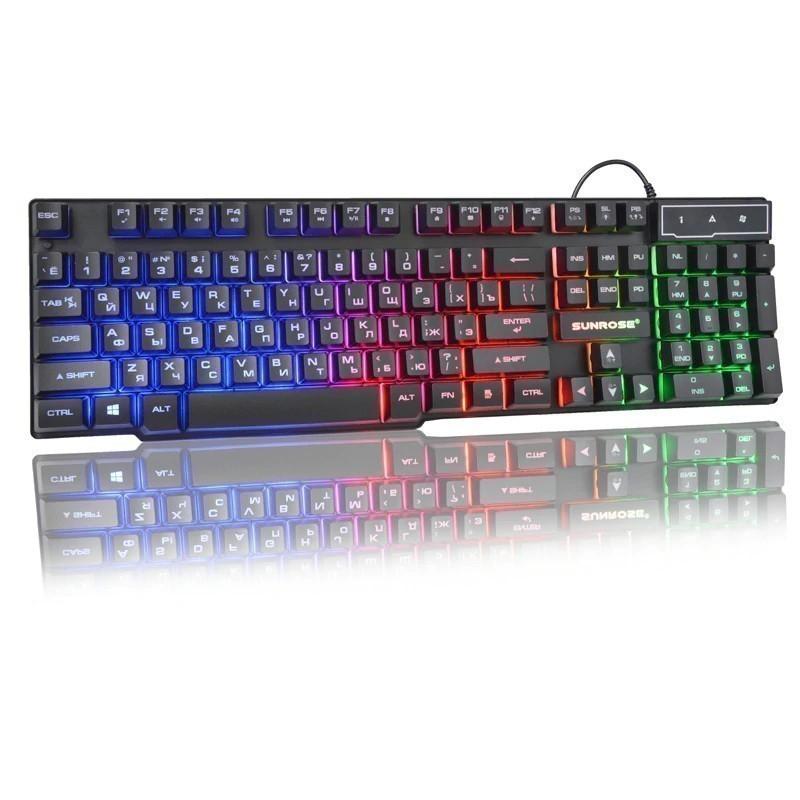 Клавиатура с подсветкой SunRose K201, черныйОстальные гаджеты<br>Если вы часто работаете за компьютером в темное время суток или любите поиграть, когда близкие люди уже спят, то обязательно обратите внимание на клавиатуру с подсветкой SunRose K201 черного цвета. Аксессуар добавит нотку волшебства в помещение, а главное – позволит вам не напрягать зрение.