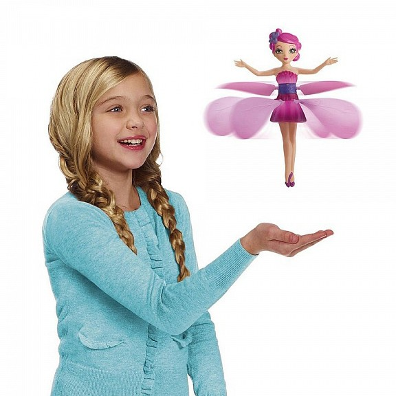 Игрушка Летающая фея - Flying FairyИгрушки для девочек<br>Что подарить маленькой мечтательнице на день рождения? Игрушка «Летающая фея» - это чудесный выбор для юных и вдохновленных натур. Flying Fairy действительно летает сама, махая лепестками юбочки, словно бабочка. Подарите волшебство вашей малышке!<br>